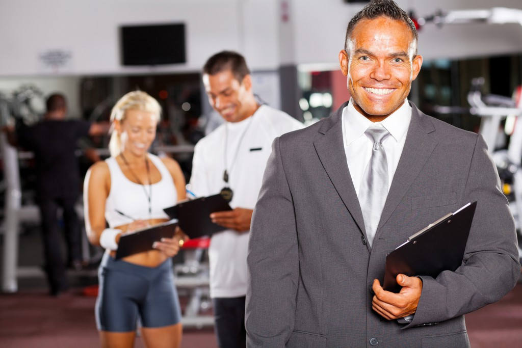 happy gym manager and trainers