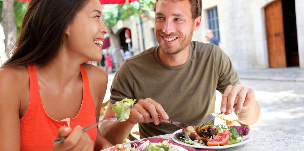 Restaurant tourists couple eating at outdoor cafe. Summer travel